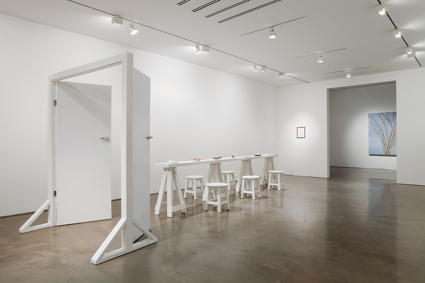 Victor Grippo ,   La comida del artista (Puerta amplia- Mesa estrecha)  ,  1991     installation; painted French door, board on four sawhorses, five wooden stools, seven ceramic plates, organic elements, gold leaves, and framed text.     84 1/2 x 63 x 216 1/2 in/ 215 x 160 x 550 cm 