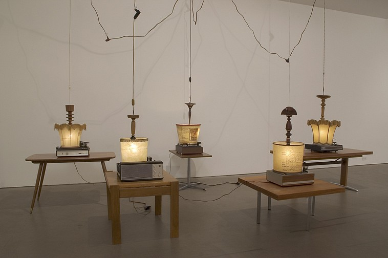 Diango Hernández ,   Drawing (Presidents' secrets)  ,  2006     6 coffee tables, 6 record players, 6 lamps, and electrical cords     dimensions variable     DH-06-SC-004